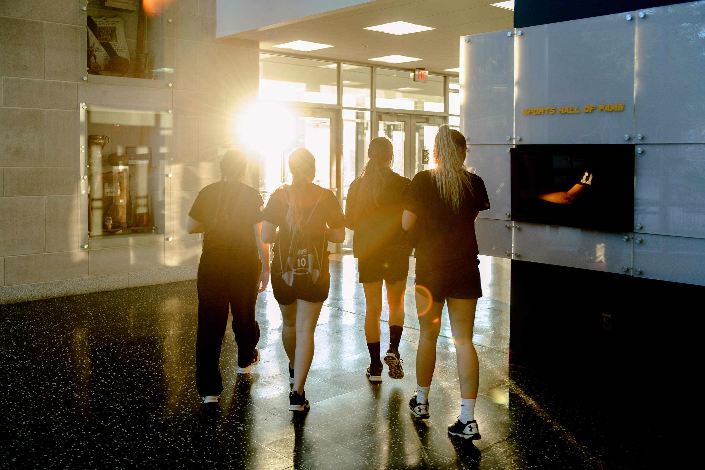 Female athletes walking together in Gill Center.