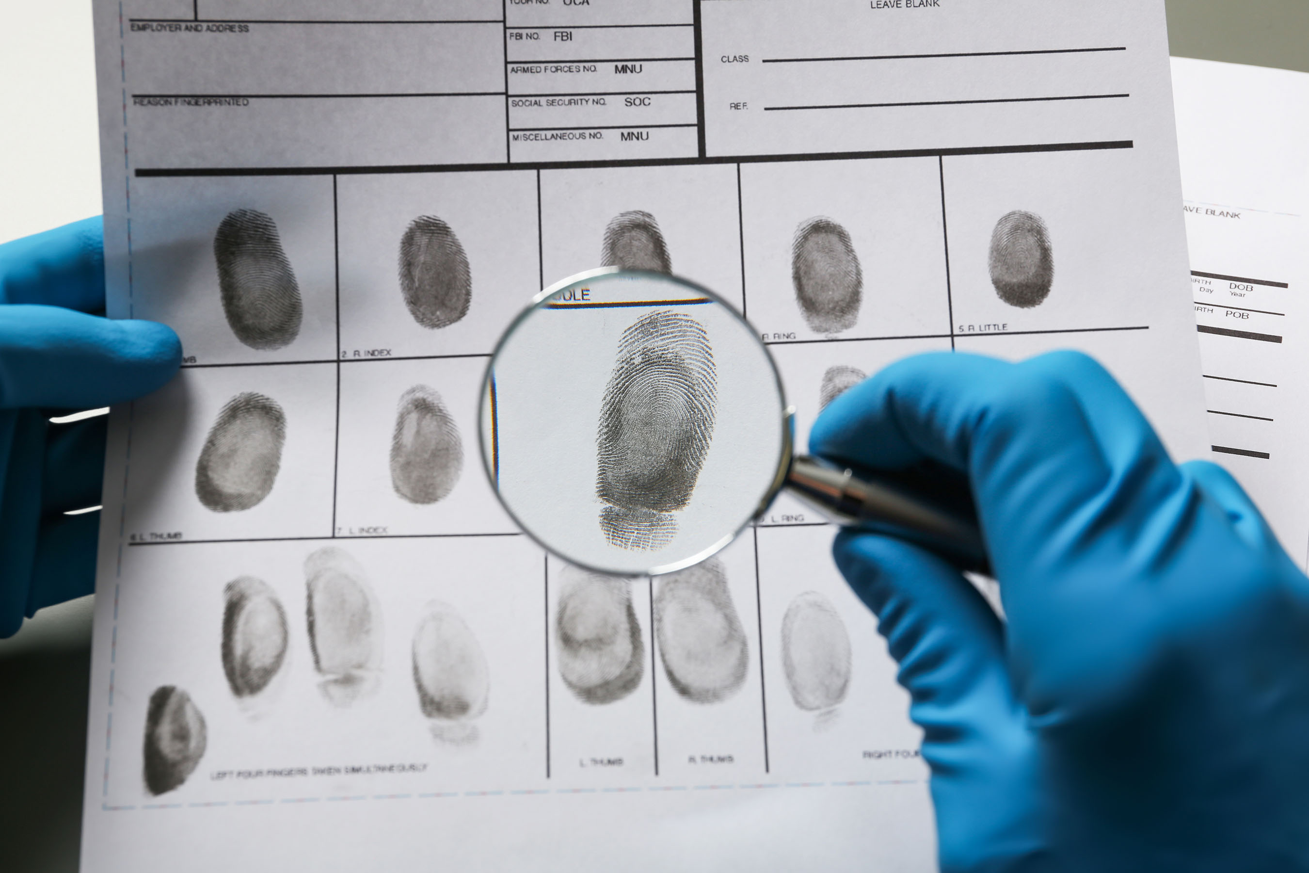 Fingerprints with magnifying glass, closeup
