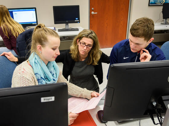 Kerry Duvall, assistant professor of accounting, assists McDaniel students during a Volunteer Income Tax Assistance (VITA) session.