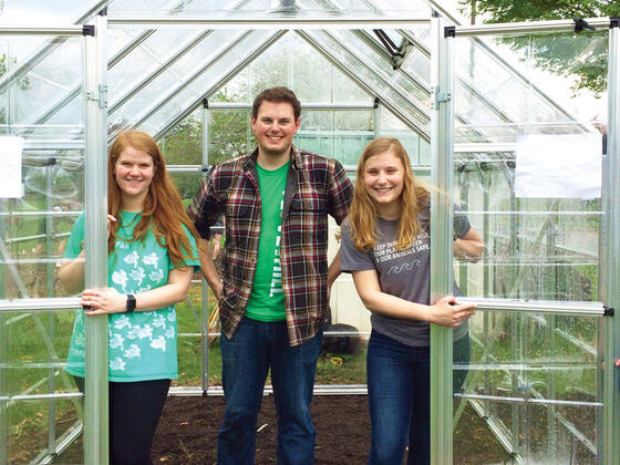 McDaniel students at the new greenhouse they purchased with their Griswold-Zepp award.