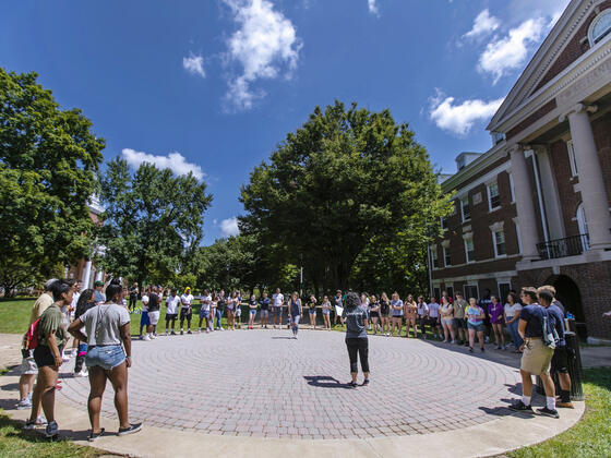 Students standing in circle on campus for McDaniel Local.