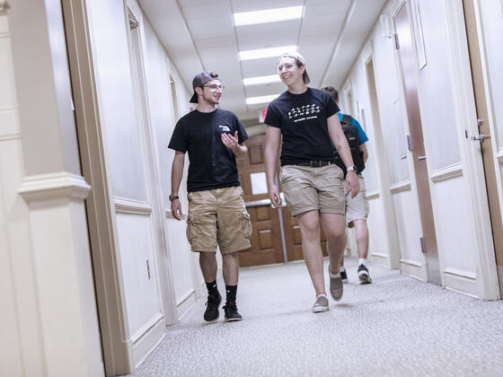 Students walking in residence hallway.