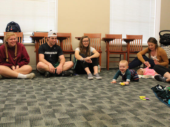 Baby interacting with a classroom full of Developmental Psychology students.