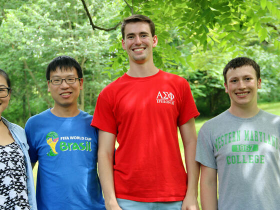 Biology professor Cheng Huang (second from left) with his research students (l-r), Molecular Biology majors Fangluo Chen, Harrison Curnutte and Garrett Gregoire.