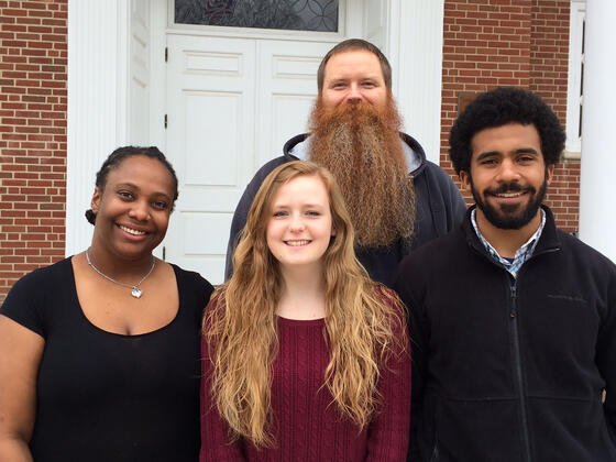 Religious Studies professor Brad Stoddard with students who presented on Religion and Race