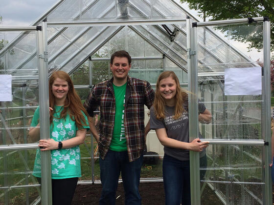 Katie Holland, Atticus Rice and Cari Witherow in McDaniel College greenhouse