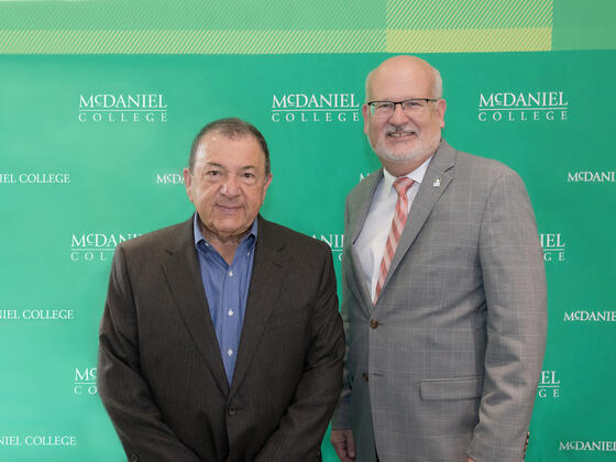 Martin K.P. Hill, current trustee and former board chair, with McDaniel President Roger N. Casey