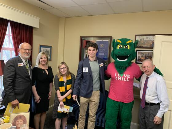 McDaniel College President Roger N. Casey with Maryland State Delegate April Rose, McDaniel students Kasey Reece and Maxwell Pardoe, the Green Terror and Maryland State Delegate Haven Shoemaker Jr.