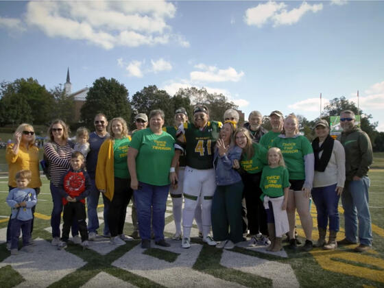 Students and family on the football field