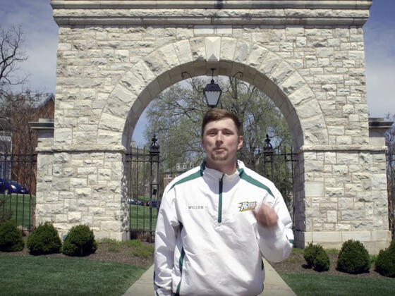 Student in front of Mcdaniel arch