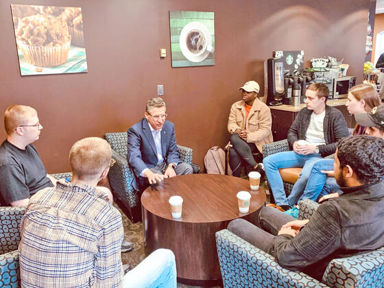 Students from the Writing for Nonprofit Organizations course visit with McDaniel College Board of Trustees member Mark Stuart, president and chief executive officer of The San Diego Foundation.
