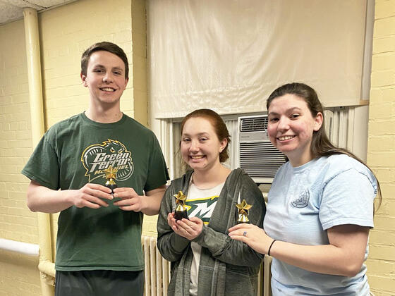McDaniel junior Zachary Ruggerie, left, with fellow students Anna Petenbrink, center, and Laura Midkiff, right.
