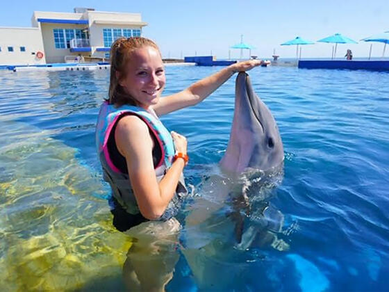 McDaniel College alumna Ashley Pritchard '16 with dolphin