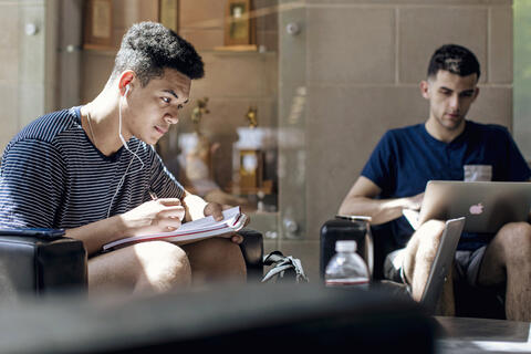 Students studying in lobby.