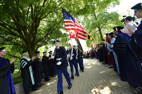 Walking the flags across campus at Commencement.