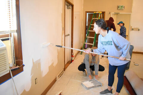 McDaniel College freshmen Abby Doff, left, and Alea Baily help paint a room at Union Street United Methodist Church on Monday.