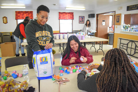 McDaniel College junior Mikayla Braswell assists freshmen Kaeana Aguon and Cammie Beazer with sorting and stuffing plastic eggs for the City of Westminster on Martin Luther King Jr. Day.