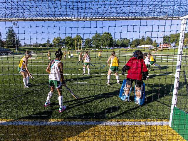 Field Hockey players in action on the field.