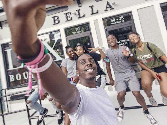 Students taking selfie around downtown Westminster during McDaniel Local.
