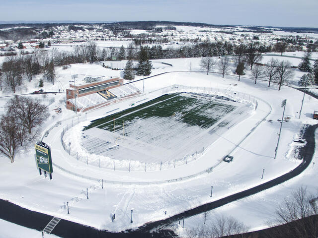 Aerial photo of McDaniel College football stadium covered in snow.