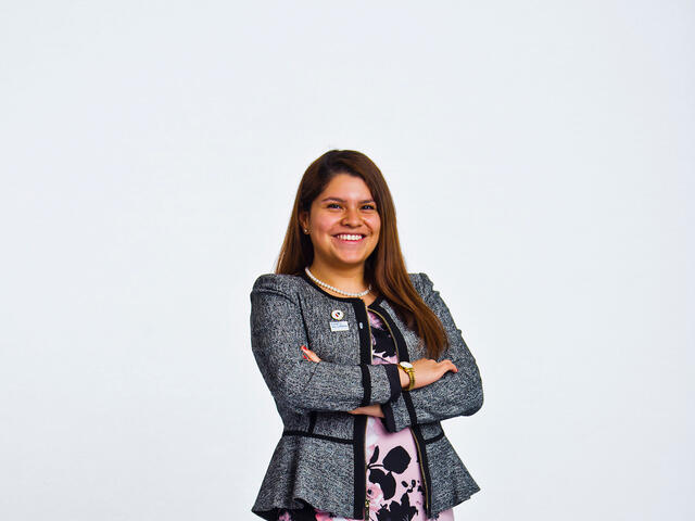 Jasmin Chavez standing in front of a white background.