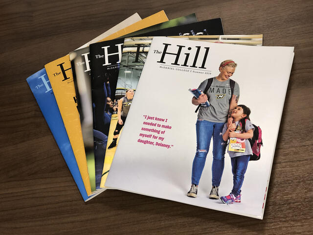 The Hill magazine covers stacked on table.