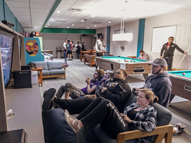 Students playing video games in Rec Room on campus.