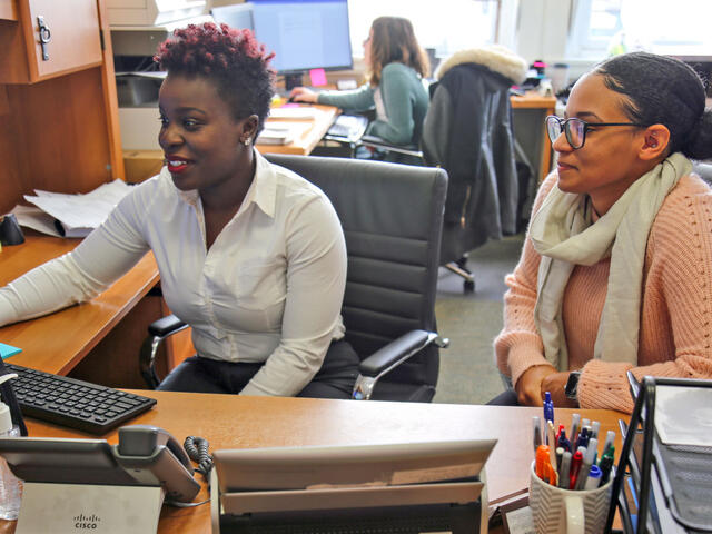 McDaniel College Financial Aid Director Kemia Himon assists Financial Aid Specialist Aza Smith