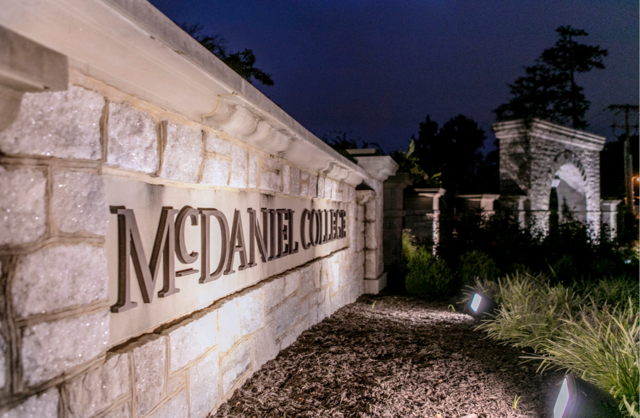 McDaniel campus sign in front of arch