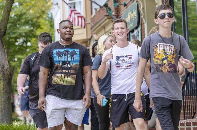 Students walking around downtown Westminster during McDaniel Local.