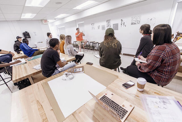 Art professor and students in art studio.