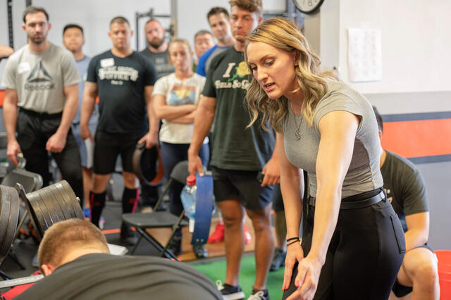 Nicole Rutherford '16 teaches the deadlift as a platform coach at the L.A. Starting Strength seminar.
