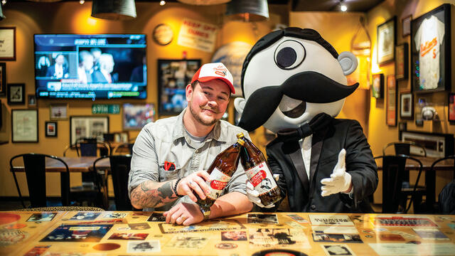 Christopher Molloy, National Bohemian brand manager, and Boh, the mascot