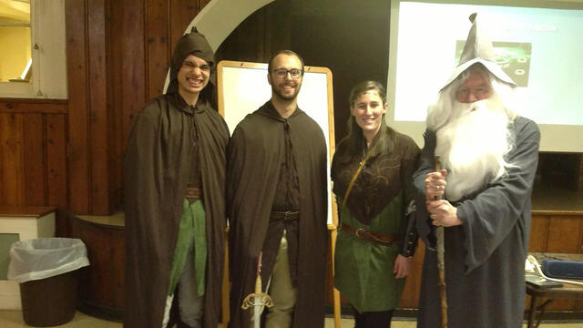 Psychology professor Paul Mazeroff with students presenting on Tolkien's Lord of the Rings