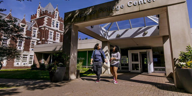 Two students walking out of Decker College Center.